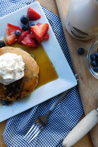 These vegan blueberry buttermilk pancakes will have you wanting a homecooked breakfast every weekend. In out home, it's our go-to Sunday breakfast!